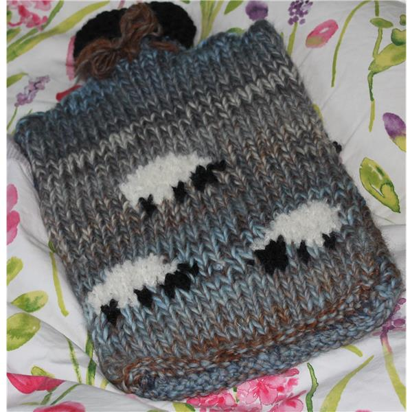 Comfy, cuddly hotwater bottle cover with sheep motif