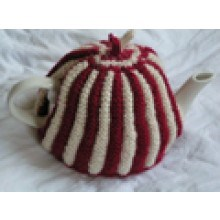 Knitted red rouched tea cosy