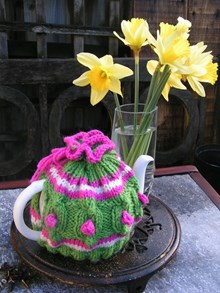 Knitted springtime tea cosy
